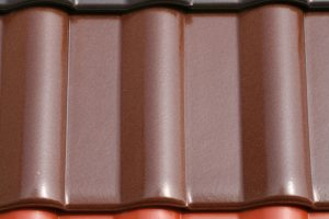 Dachbeschichtung oder beschichtete Dachpfannen