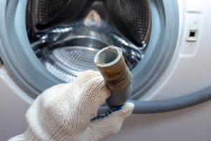 ablaufschlauch-waschmaschine-reinigen